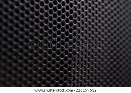 Close up of a black gray protective metal net of a speaker grille #226159612