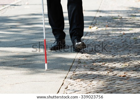 Close-up Of A Blind Man Standing With White Stick On Street #339023756