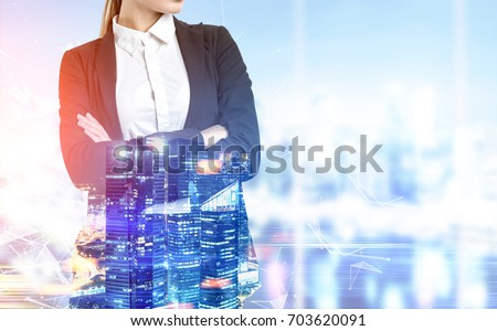 Close up of a blonde businesswoman with crossed arms standing in an office with panoramic windows. Blue cityscape. Toned image double exposure mock up #703620091