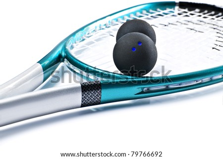 Close up of a blue and silver squash racket and ball on a white background with space for text - focus on the dots of the ball