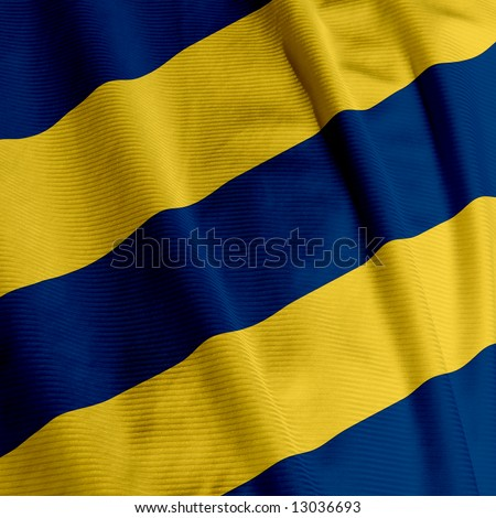 Close up of a blue and yellow colored flag