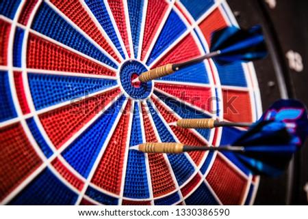 Close-up of a blue arrows on dartboard