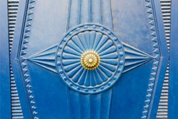 Close up of a blue art deco door pattern texture background.