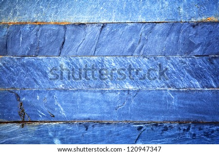 Close up of a blue brick-wall, texture background. Pattern of cracked real stone wall surface with cement