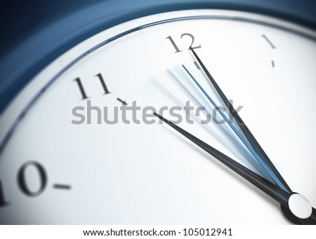 close up of a blue clock with second minute hand in movement, minute hand pointing the number 12 and minute hand pointing on eleven