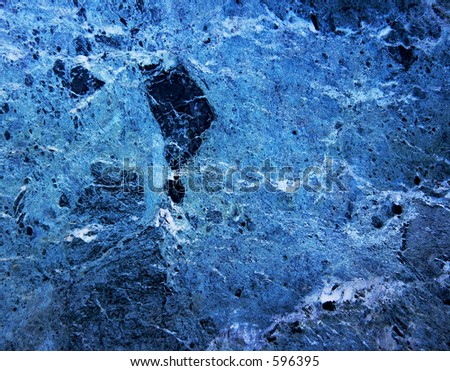 Close up of a blue marble rock wall.