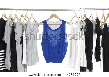 close up of a blue shirt and Fashion female clothing hanging on hangers