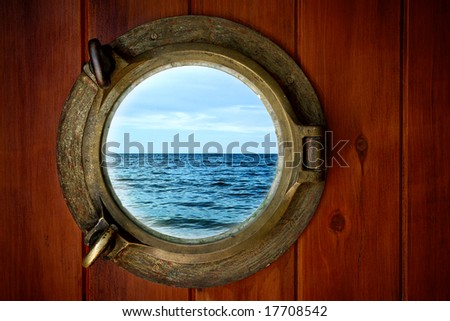 Close-up of a boat closed porthole with ocean view