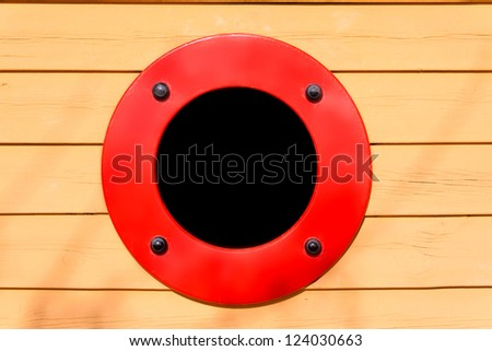 Close-up of a boat porthole with black background