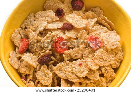 Close up of a bowl full of cereals and fruits