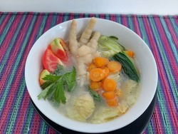 Close up of a bowl of chicken foot soup. Healthy food concept.