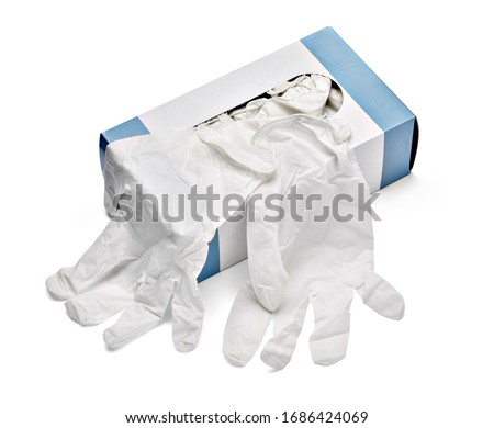 Photo of  close up of a box of white latex protective gloves on white background