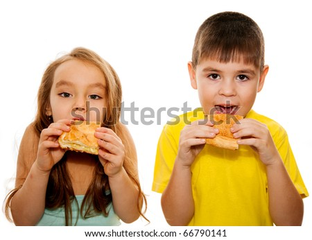 Close up of a boy and a girl with a pizza in hand isolated on white