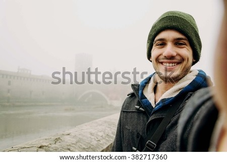 Close-up of a boy taking a selfie of himself, on Holiday - lifestyle, people, outdoor and Holiday concept