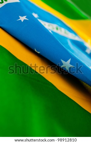 Close up of a Brazilian flag lying on the floor