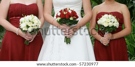 Close-up of a bride and her bridesmaids holding beautiful bouquets.