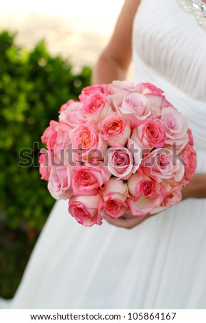 Close-up of a bride holding her wedding bouquet.