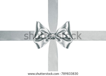 close up of a bright silver satin ribbon bow with crosswise ribbons on white background #789833830