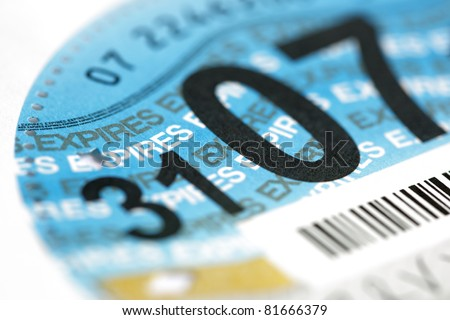 Close up of a British road tax disc