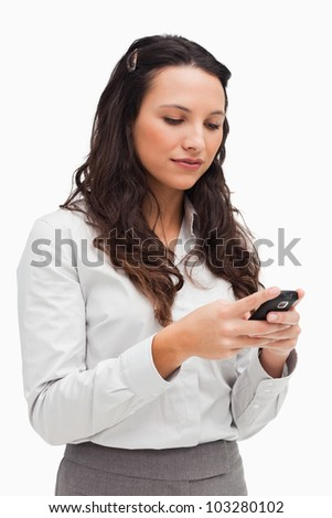 Close-up of a brunette texting against white background