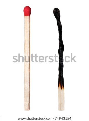 Close-up of a burnt match and a whole red match isolated on a white background