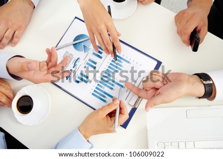 Close-up of a business team discussing graphs and charts