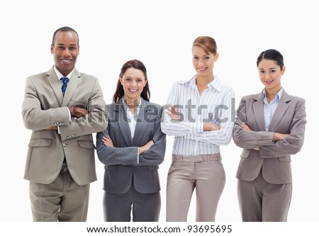 Close-up of a business team smiling side by side and crossing their arms against white background