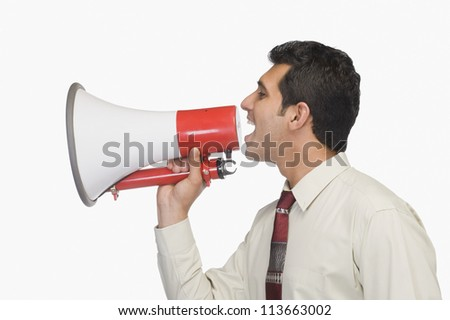 Close-up of a businessman announcing into a megaphone
