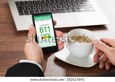 Close-up Of A Businessman Checking Credit Score Online On Cellphone While Having Coffee #282625841