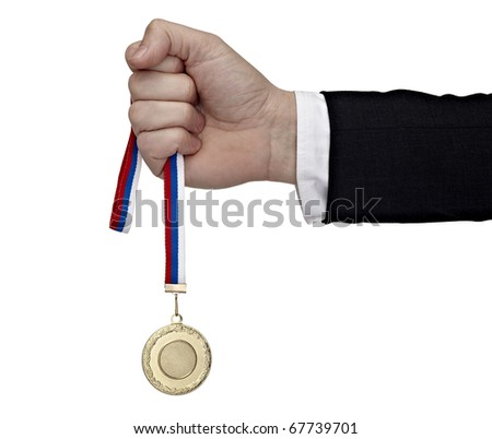 close up of a businessman hand holding golden medal on white background with clipping path