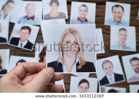 Close-up Of A Businessman Making Candidate Selection Over The Desk At Workplace