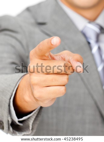 Close-up of a businessman pointing at the camera against a white background