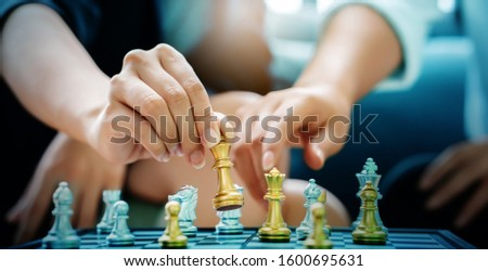 Close up of a businessman's hand is moving chess Strategic marketing planning by competitor analysis will make business successful as planned. Mergers or joint operations. Concept honest work