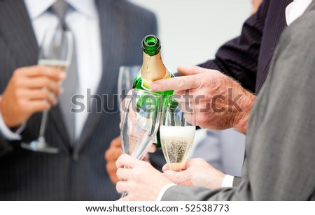 Close-up of a businessman serving Champagne in the office
