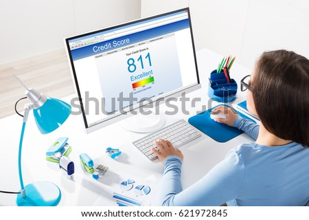 Close-up Of A Businesswoman Checking Credit Score On Computer At Workplace #621972845