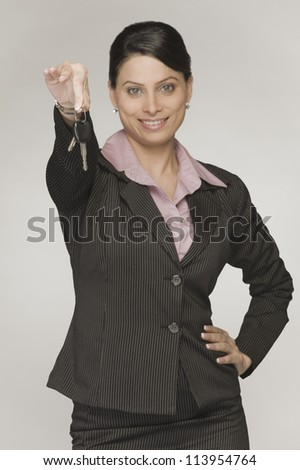 Close-up of a businesswoman showing a car key
