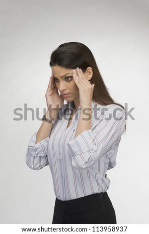 Close-up of a businesswoman suffering from a headache