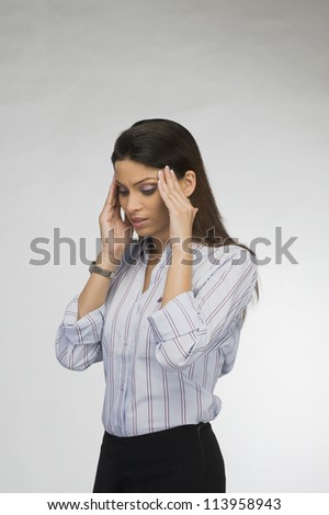 Close-up of a businesswoman suffering from a headache