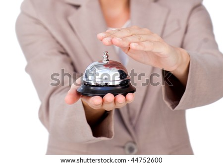 Close-up of a businesswoman using service bell against a white background