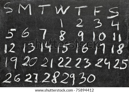 close up of a calendar on a blackboard