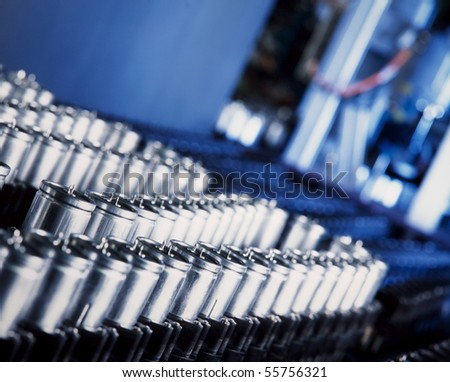 close up of a capacitor production machine