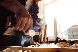 Close up of a carpenter drilling a hole in timber