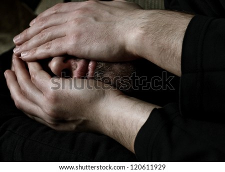 Close up of a Caucasian man covering face with hands from desperation - stock photo