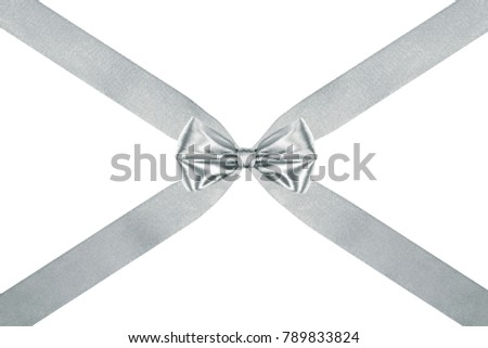 close up of a celebration silver silk ribbon bow with crosswise ribbons on white background #789833824
