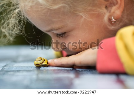 close up of a child and snail