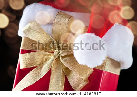 Close-up of a christmas present with defocused glittering lights background