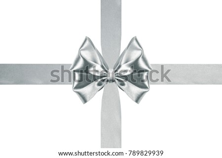 close up of a Christmas silver satin ribbon bow with crosswise ribbons on white background #789829939