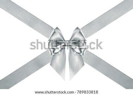 close up of a Christmas silver silk ribbon bow with crosswise ribbons on white background #789833818