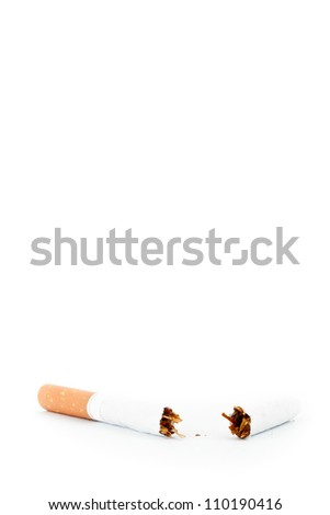 Close up of a cigarette broken against a white background