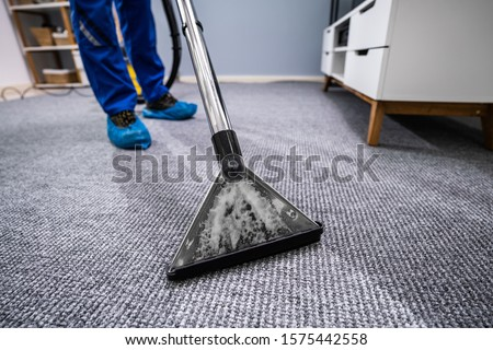 Close-up Of A Cleaning Carpet With Vacuum Cleaner Stockfoto ©